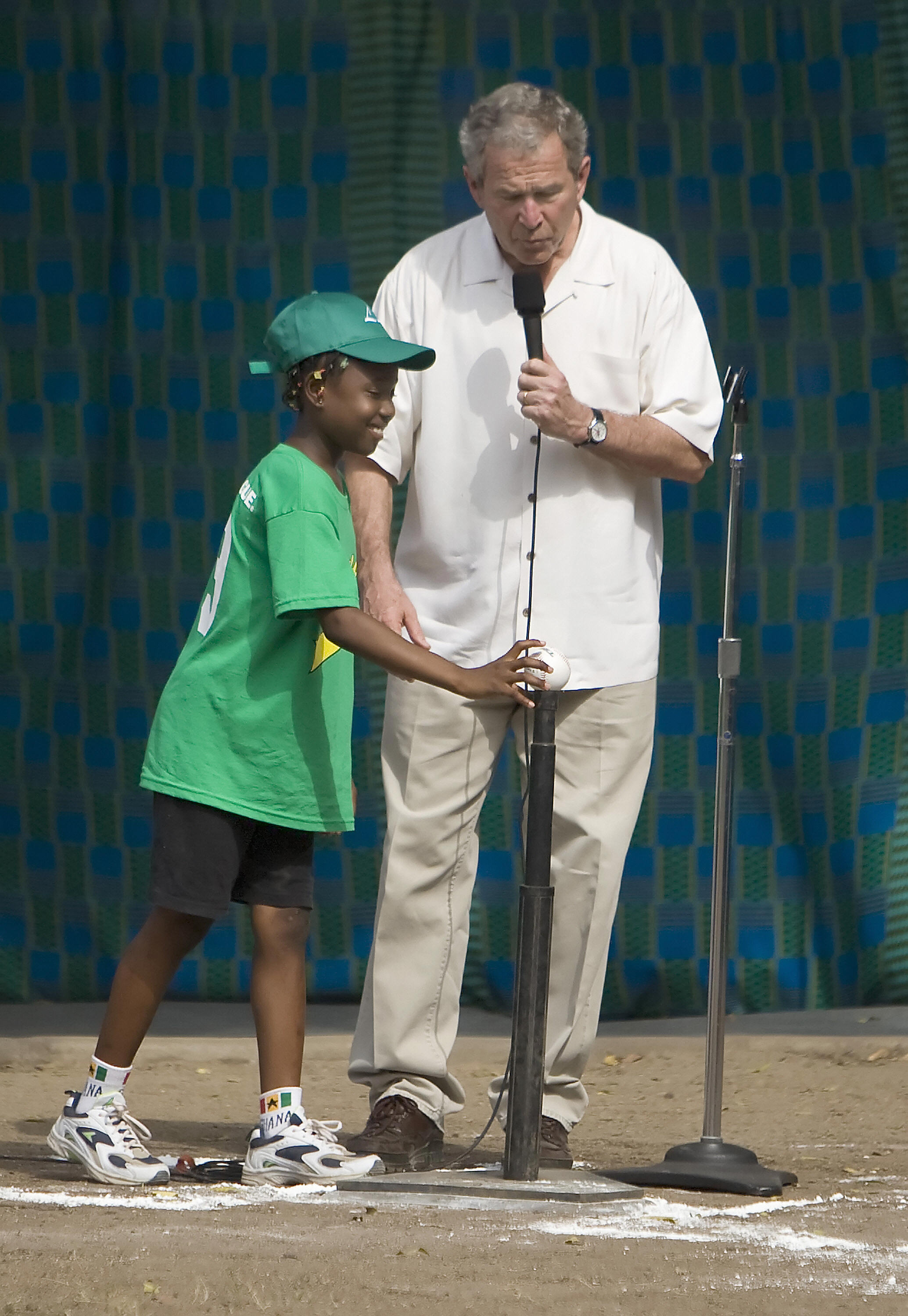 Bush starts a t-ball game in Ghana.