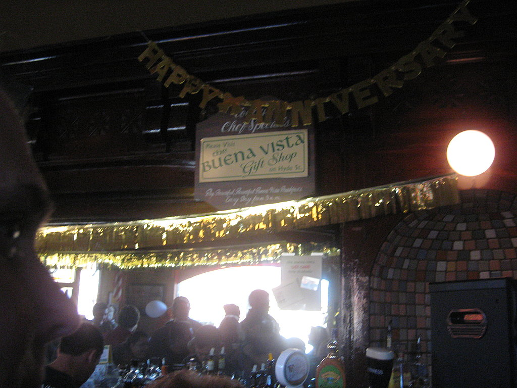 The bar is decorated with anniversary signs.