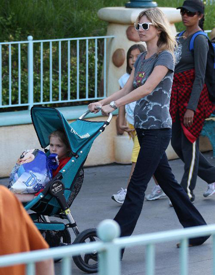 Kate Moss pushed her babe, Lila Grace around Disneyland this weekend. Looks like Lila's enjoying the States!