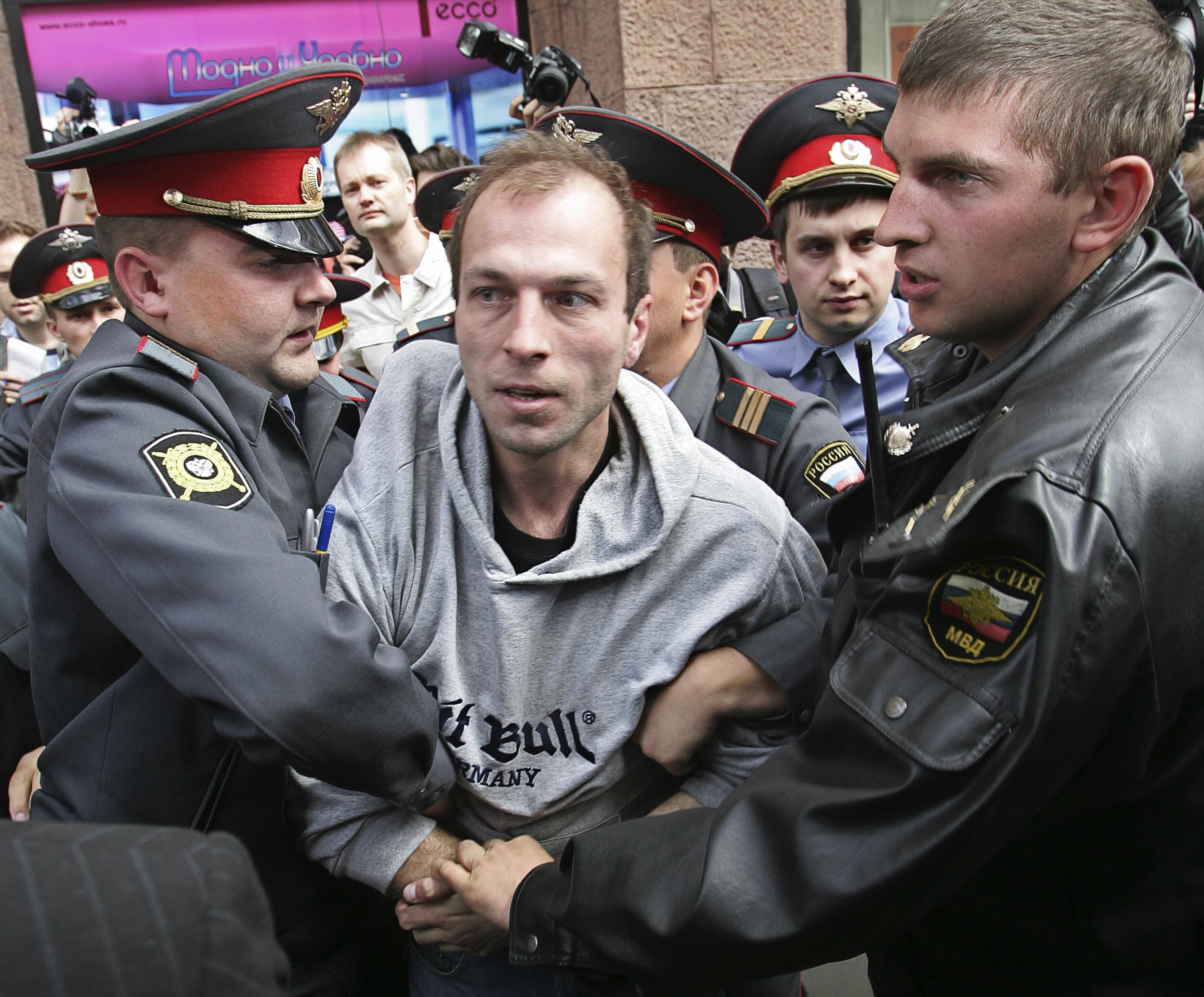 Russian police forces arrest a far-right activist during a banned gay rally.
