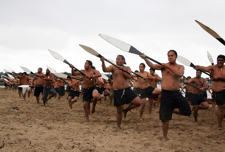 Maori warriors practice a haka at Te Ti Bay the day before Waitangi Day (NZ's national holiday).