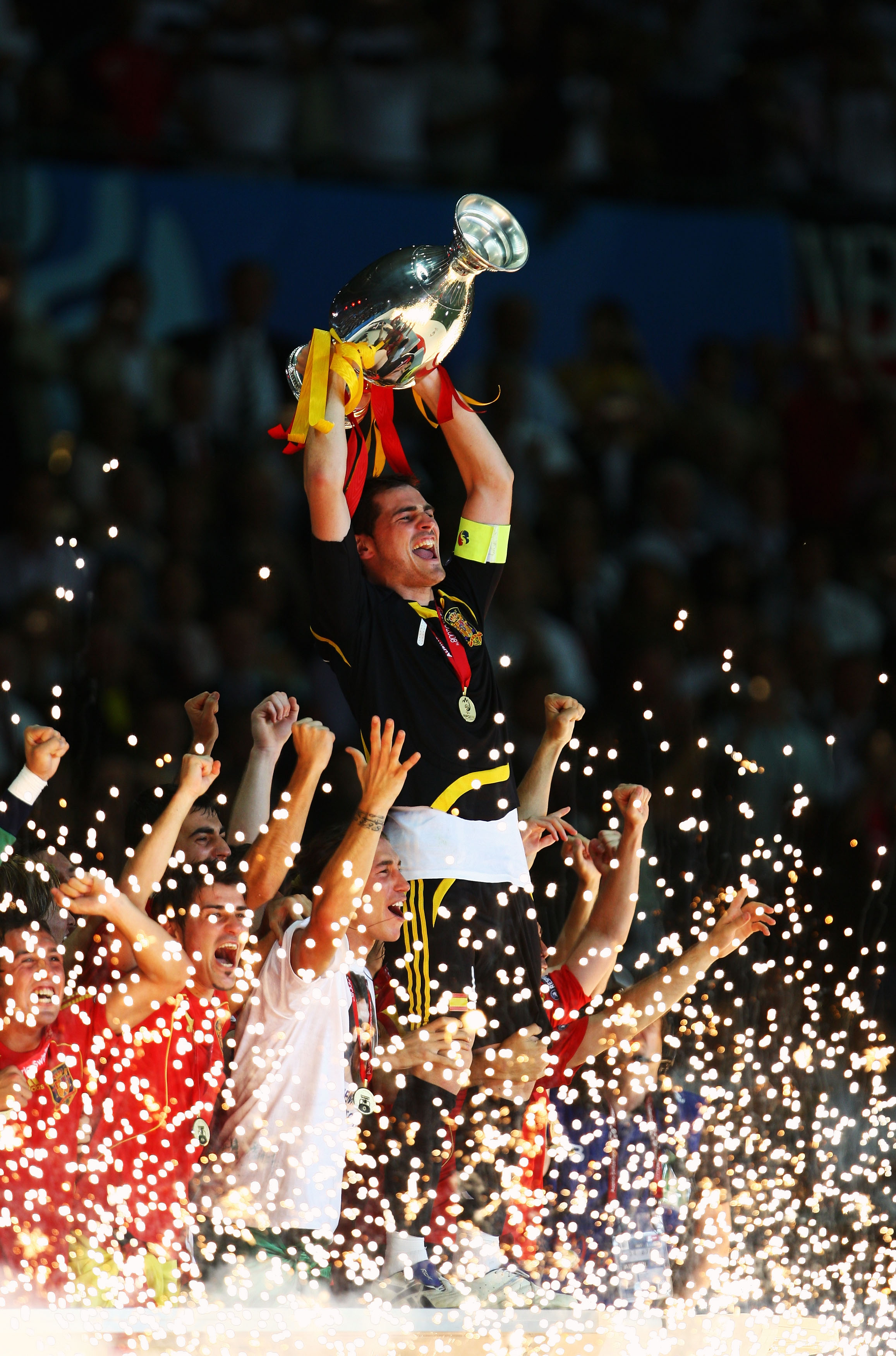 Captain Iker Casillas of Spain lifts the trophy after winning.