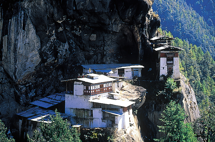 Taktsang monastery at Tiger's Lair, sacred Buddhist cave shrine perched high on cliff.