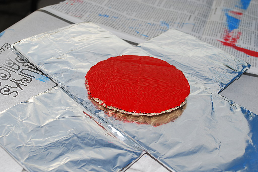 Once the circle is dry, staple to the center of the propellers.