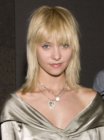 Photo of Gossip Girl Actress Taylor Momsen with Bangs New Fringe Hair at New York Fashion Week. Bleach Blonde Mullet Style Trend