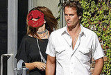 Celebrity Photo Quiz: Guess Which 90's Supermodel is Shwing Off Super Shiny Hair and Her Husband in Hollywood?