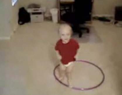 Baby Tries to Hula Hoop