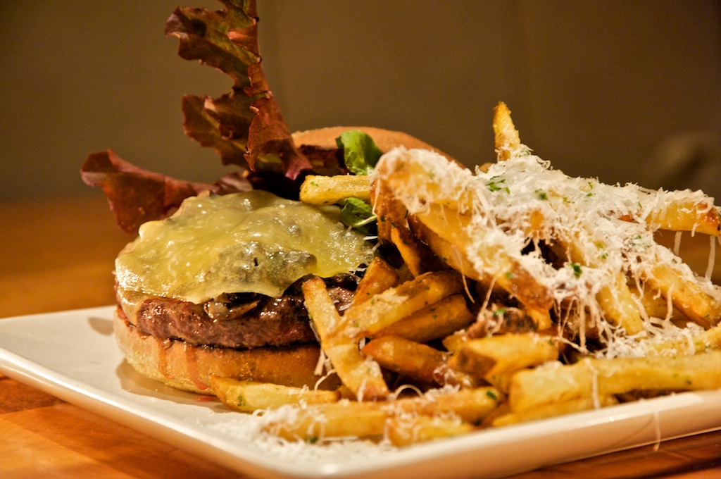Prather ranch beach burger with aged gouda, caramelized onion, mushroom, kennebec fries