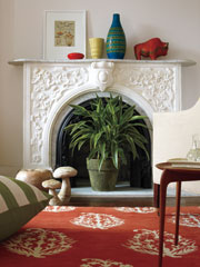 5 ways to decorate a non working fireplace popsugar home - Decorate non working fireplace ...