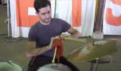 Man Knits While Playing Drums