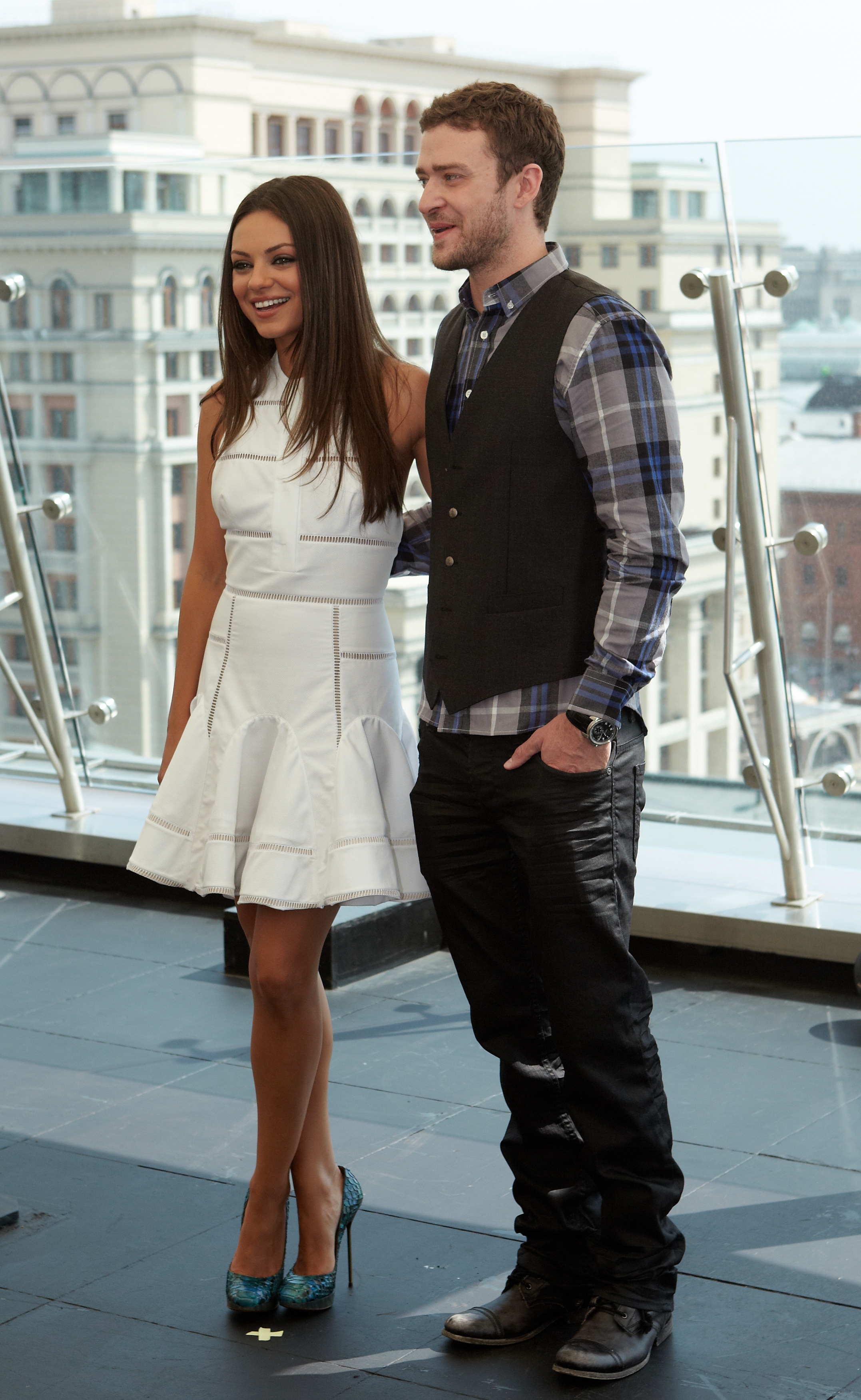Justin Timberlake wears a plaid shirt and a vest.