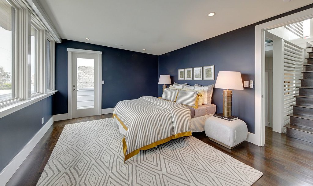 Aside from the beautiful navy blue walls, this bedroom ...