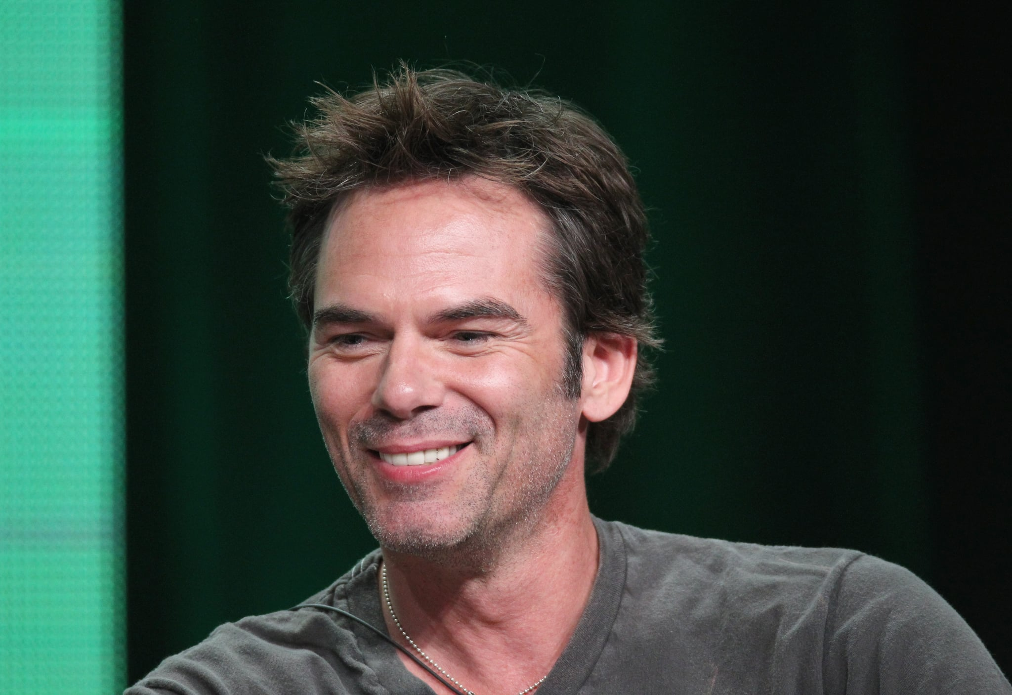 Billy Burke addressed the press from the stage.
