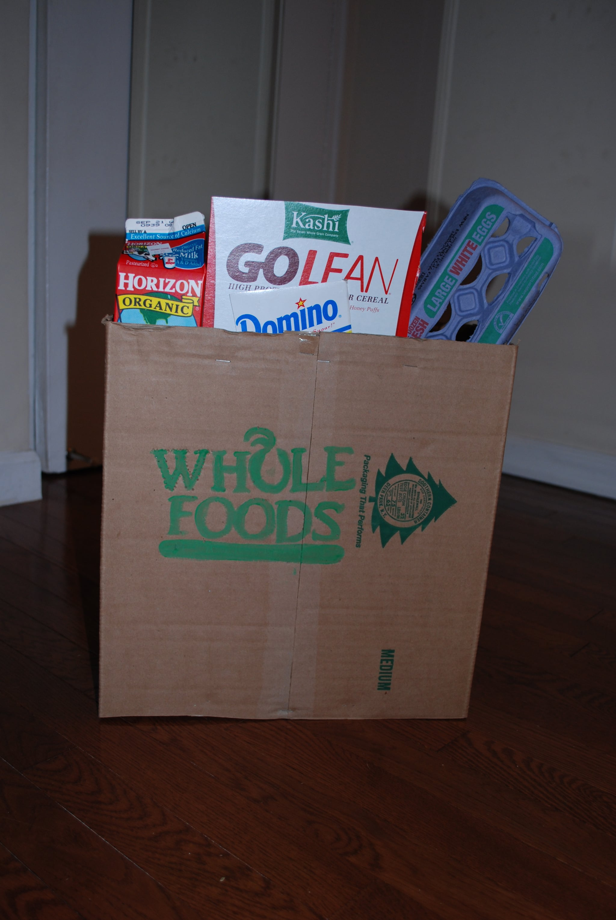 Attach the empty boxes and cartons to the inside of the box with a stapler or glue.