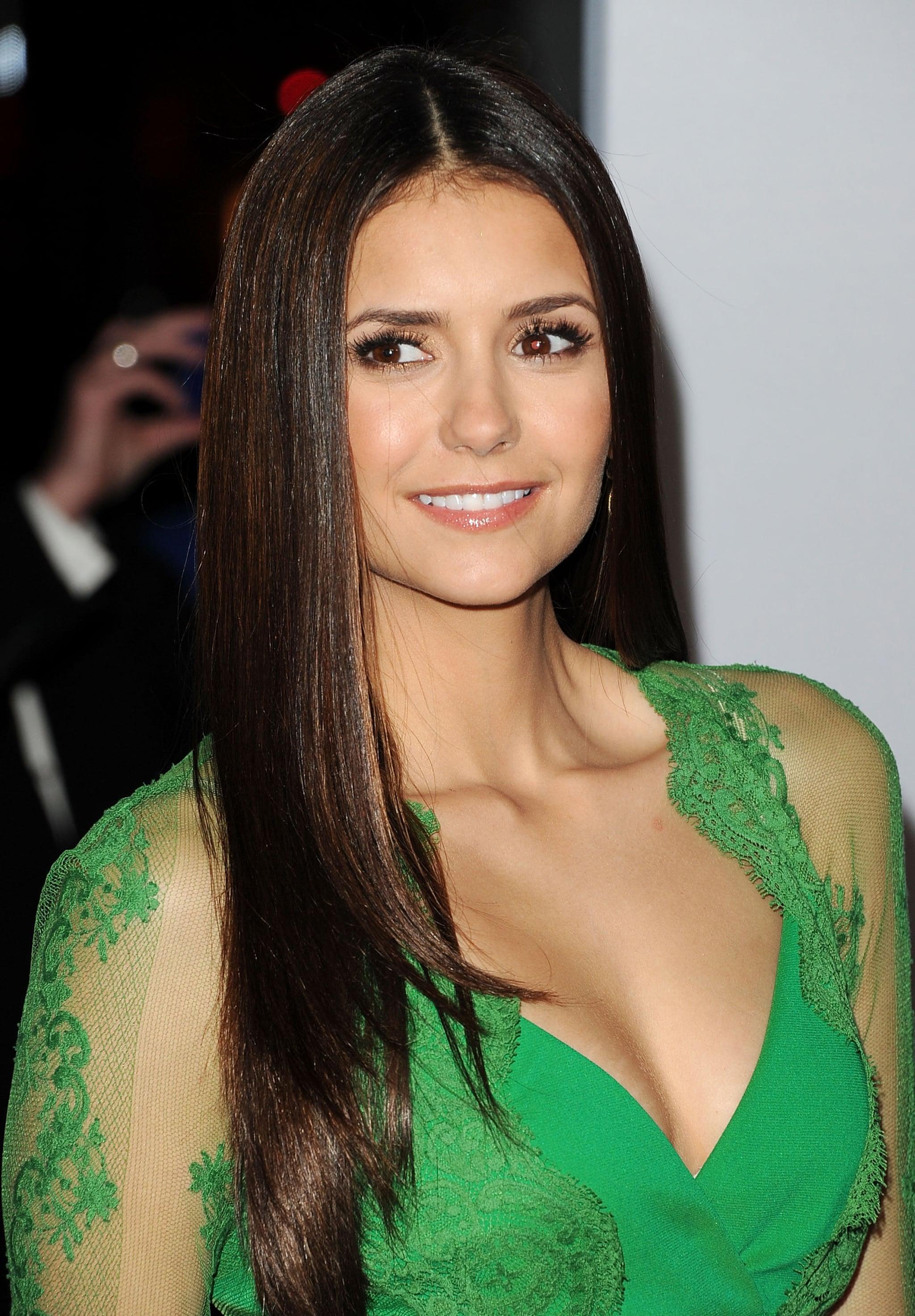 Nina Dobrev smiled on the red carpet.