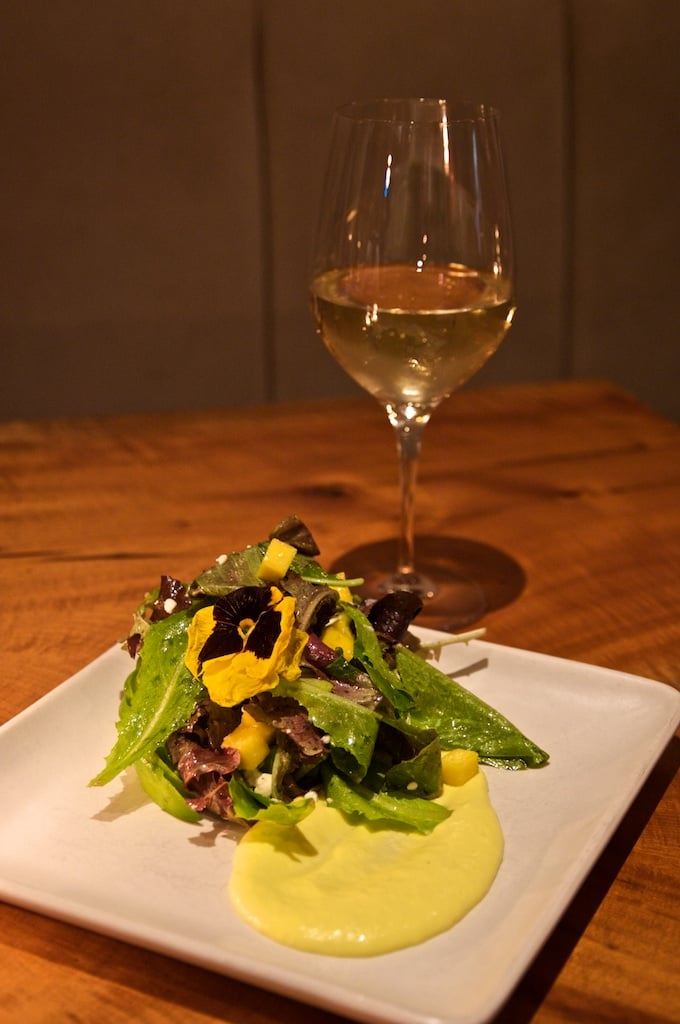 Avocado and mango salad with baby greens, barrel aged feta, white balsamic vinaigrette
