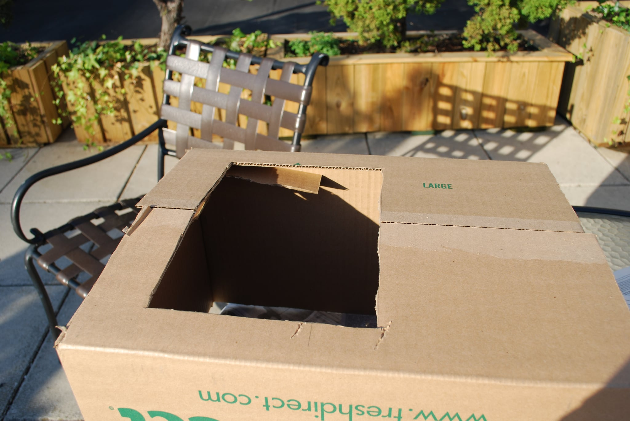 Next, cut an opening out of the top of the box that will allow it to go over your child's head and rest of his shoulders.