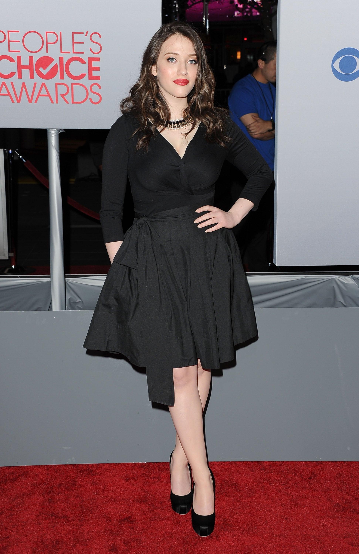 Kat Dennings in a black dress.