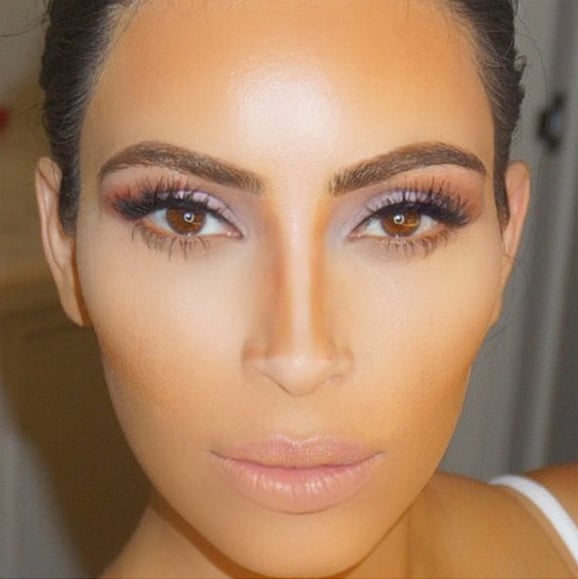 fb8687c9920 Kim Kardashian is clearly the master of contouring and highlighting with  makeup. Thanks to one unfinished-glam selfie, Kim is sharing her beauty  secrets to ...