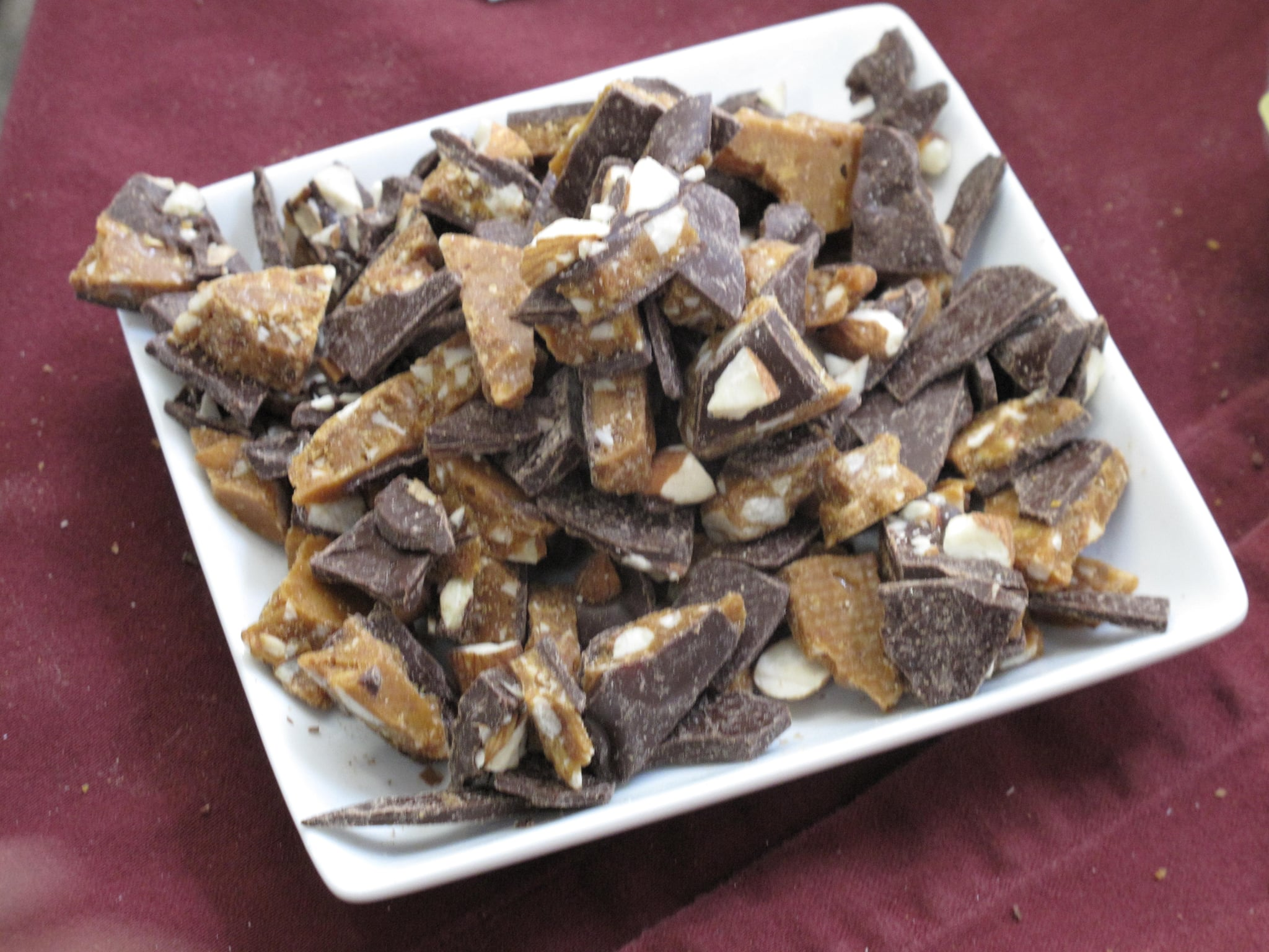 Dolce Bella Chocolates made an almond toffee from fresh roasted central valley almonds, Guittard 61 percent dark chocolate, and lots of butter.<br />