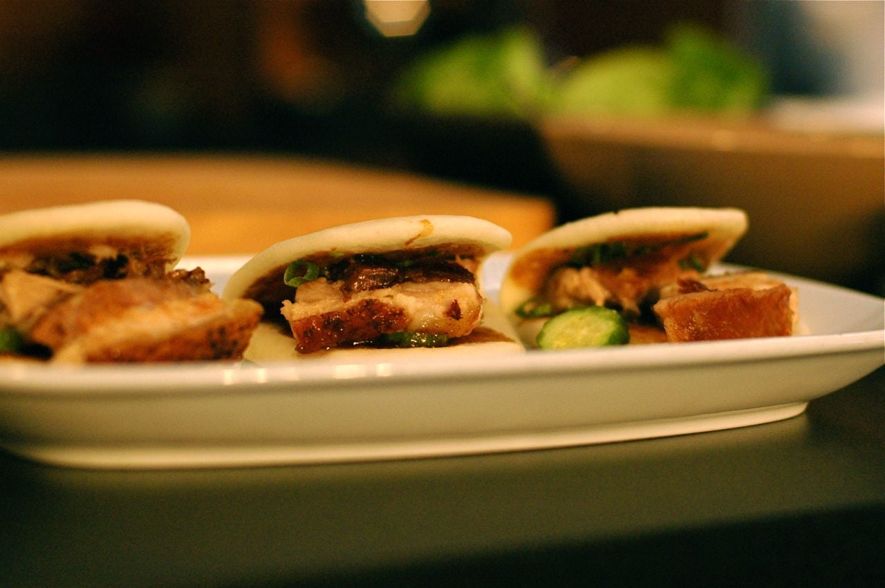 Rocco and I chatted while noshing on David Chang's pork buns.