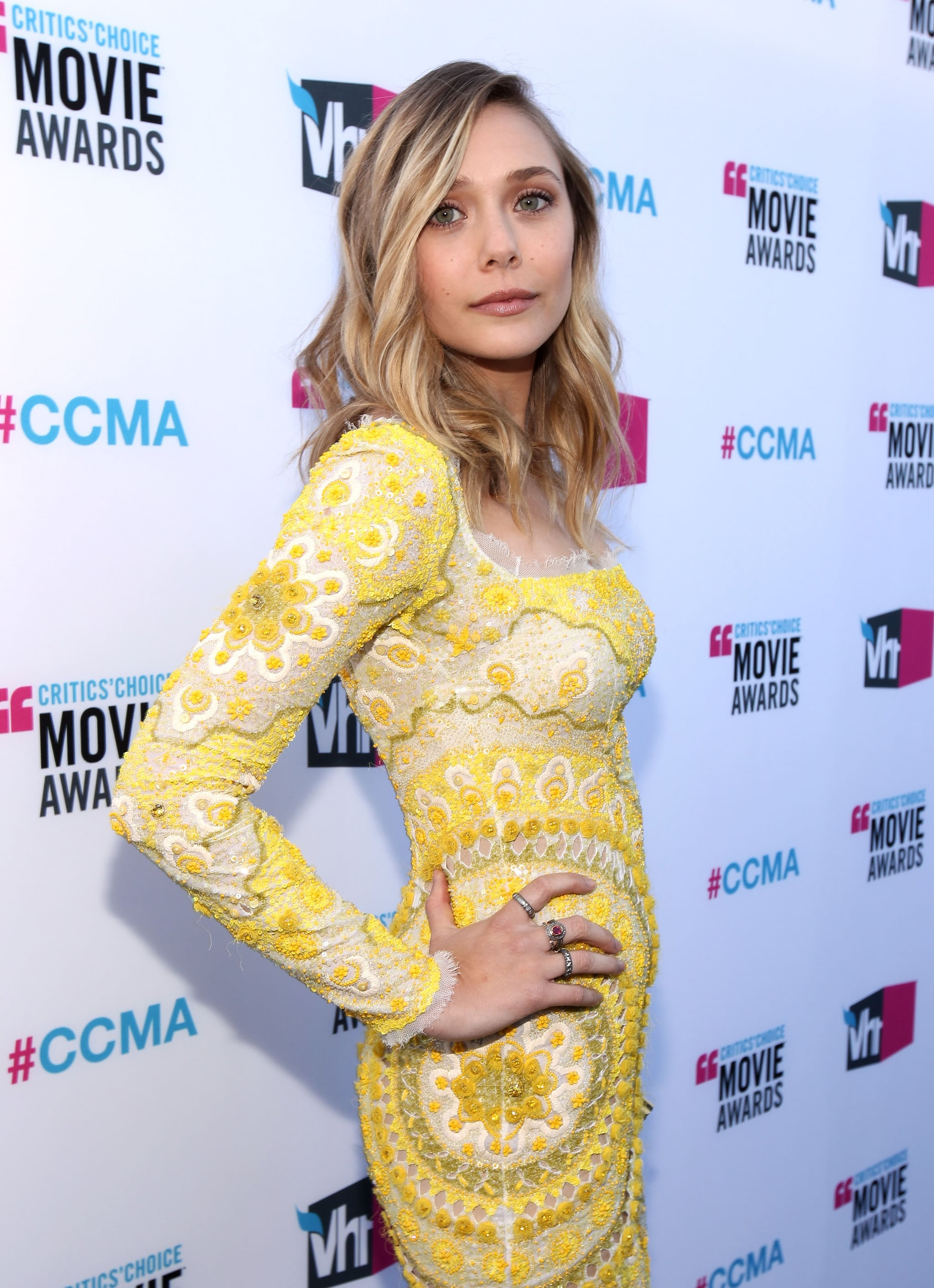 Elizabeth Olsen showed off her yellow Emilio Pucci dress.