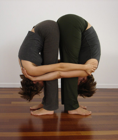 partner yoga pose double standing forward bend  popsugar